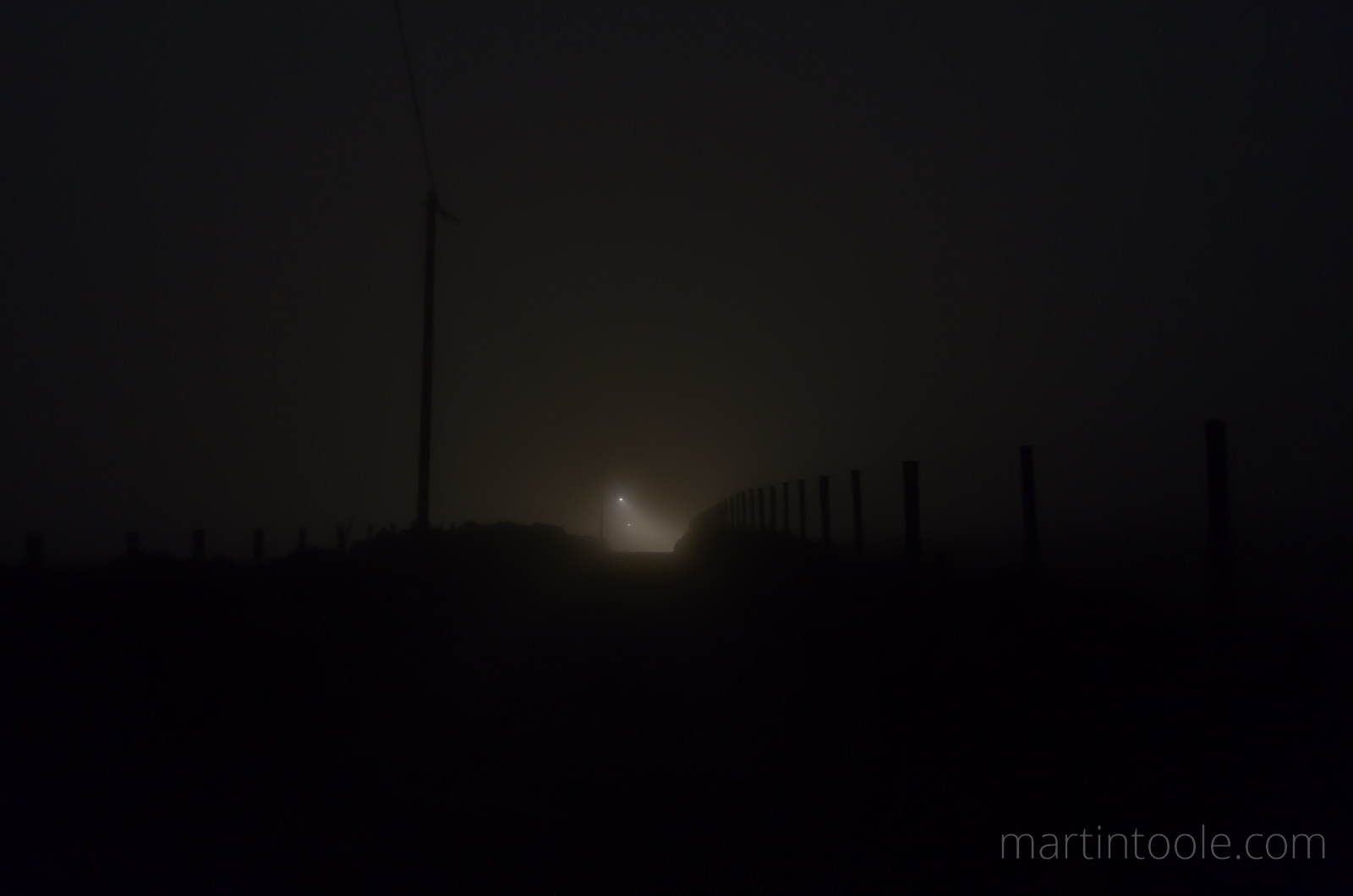 eery country lane at night in the clouds