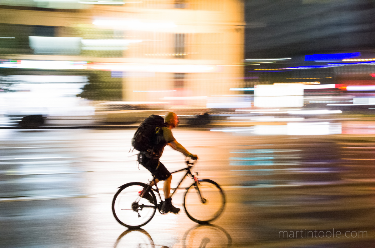 cyclist in berlin on an evening
