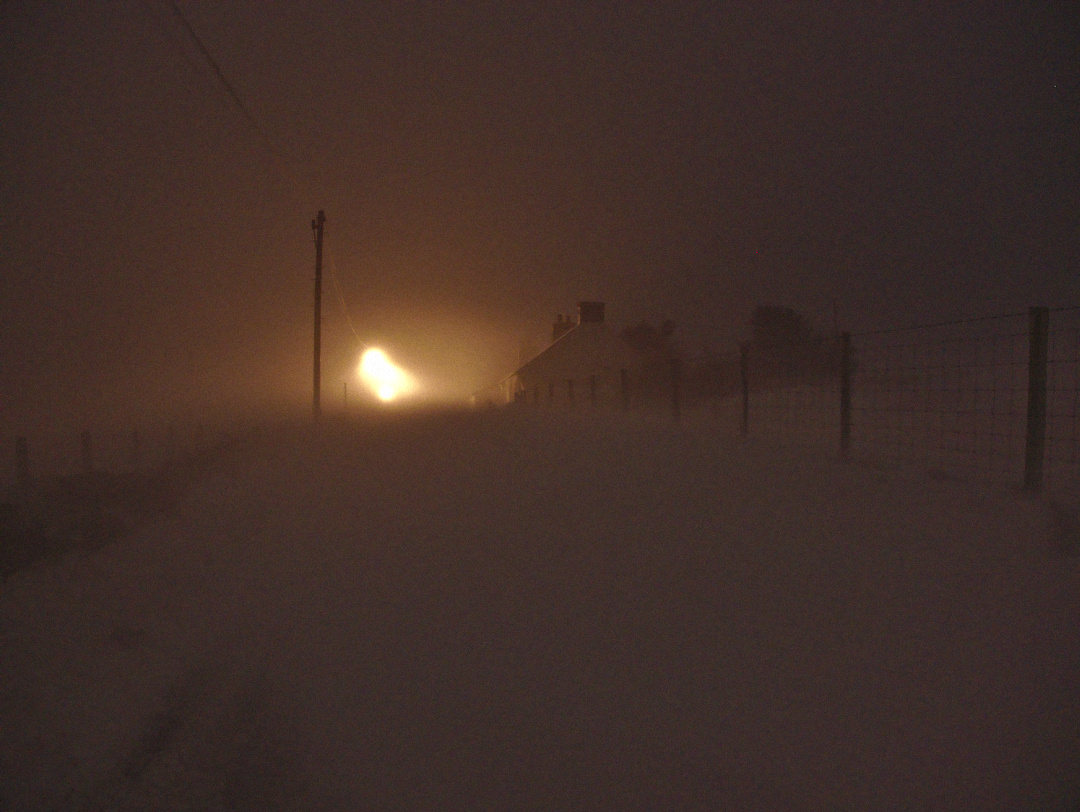 snow blizzard with big drifts across the road at mount pleasant, llithfaen, wales